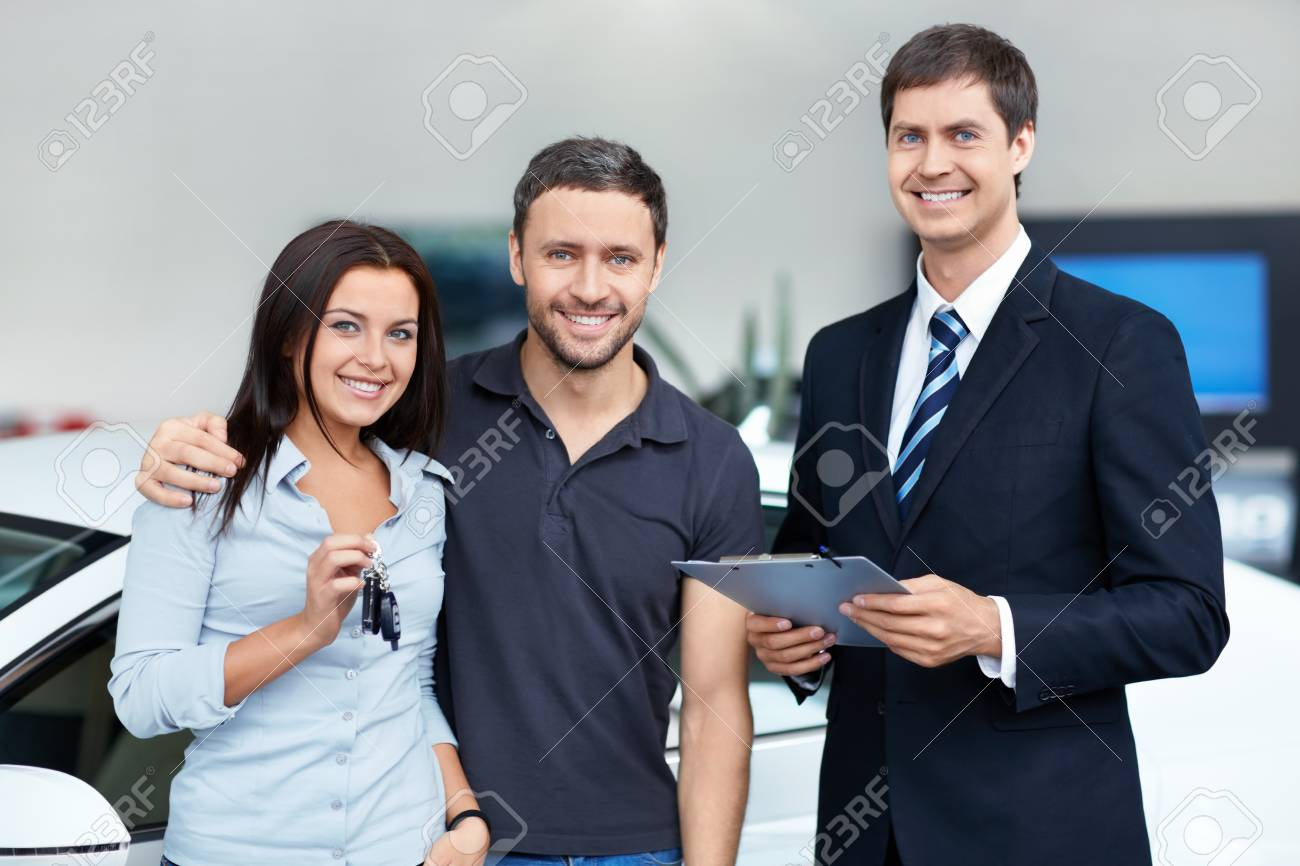 Seller and a couple in the showroom Stock Photo - 15573203