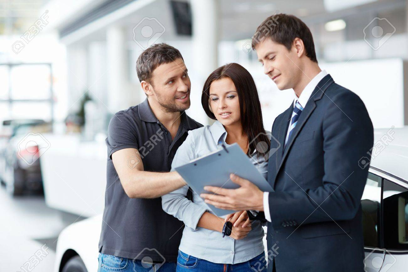 Seller and buyer in the showroom Stock Photo - 15880531