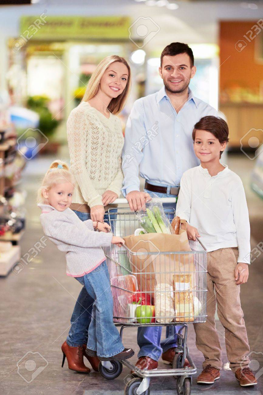Family with children in shop Stock Photo - 18357765