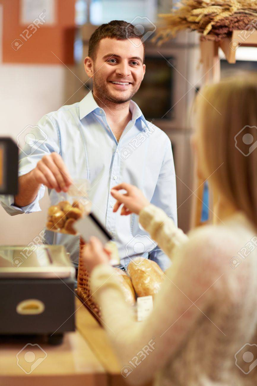 Young girl in a store buying product Stock Photo - 18661117