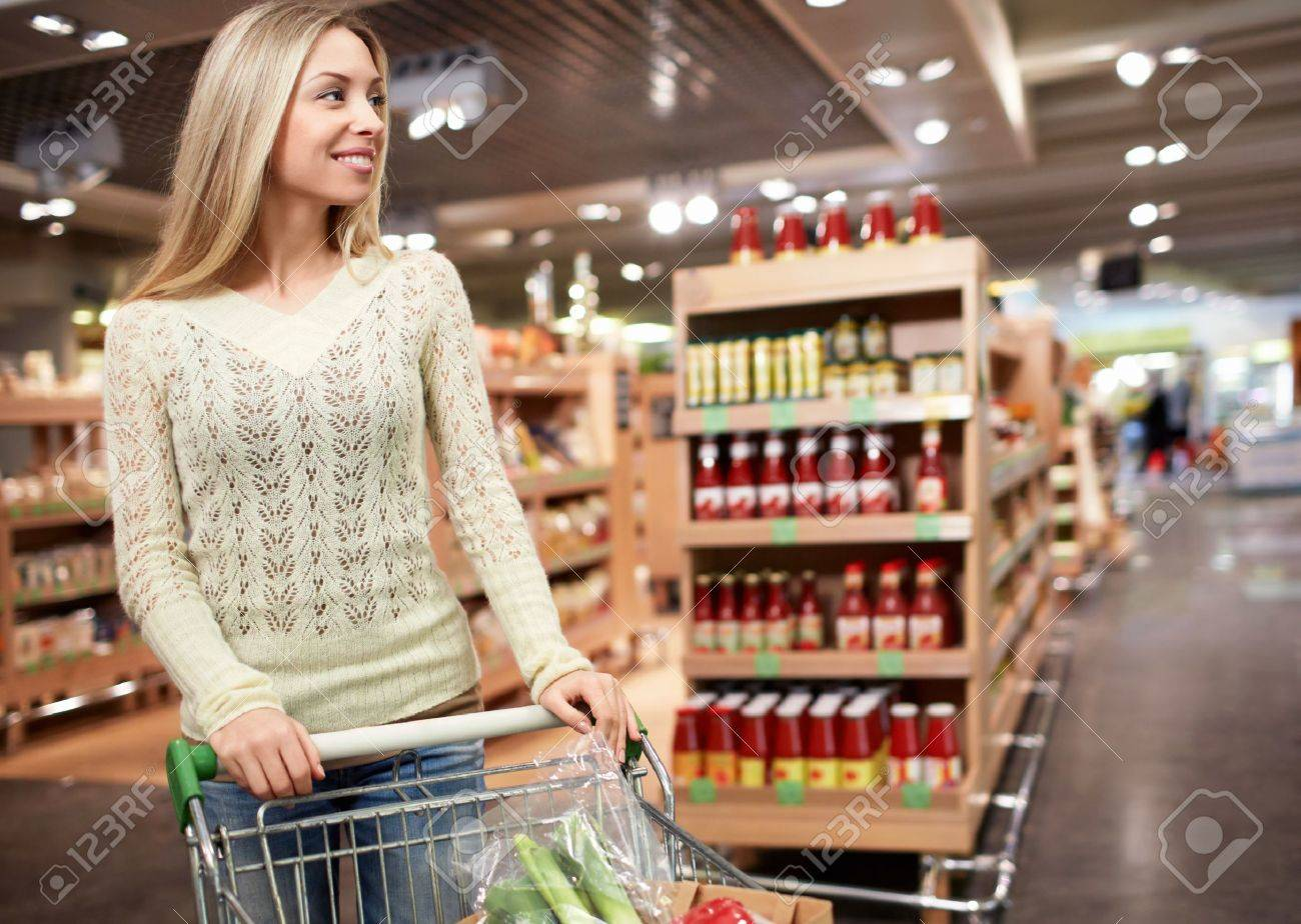 Young girl with a cart in the store Stock Photo - 18941078
