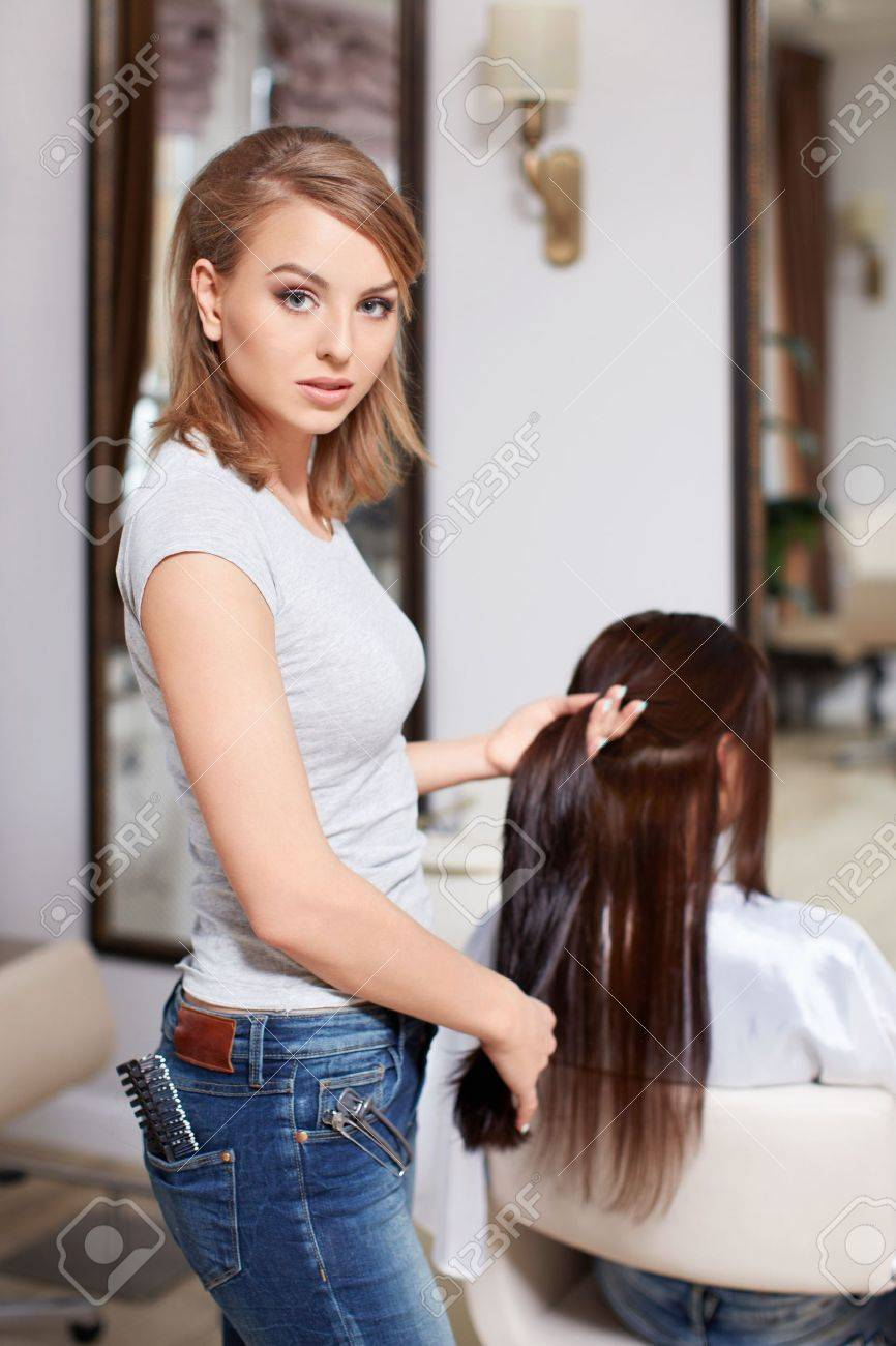 Hairdresser makes hairstyle at the beauty Stock Photo - 19360291