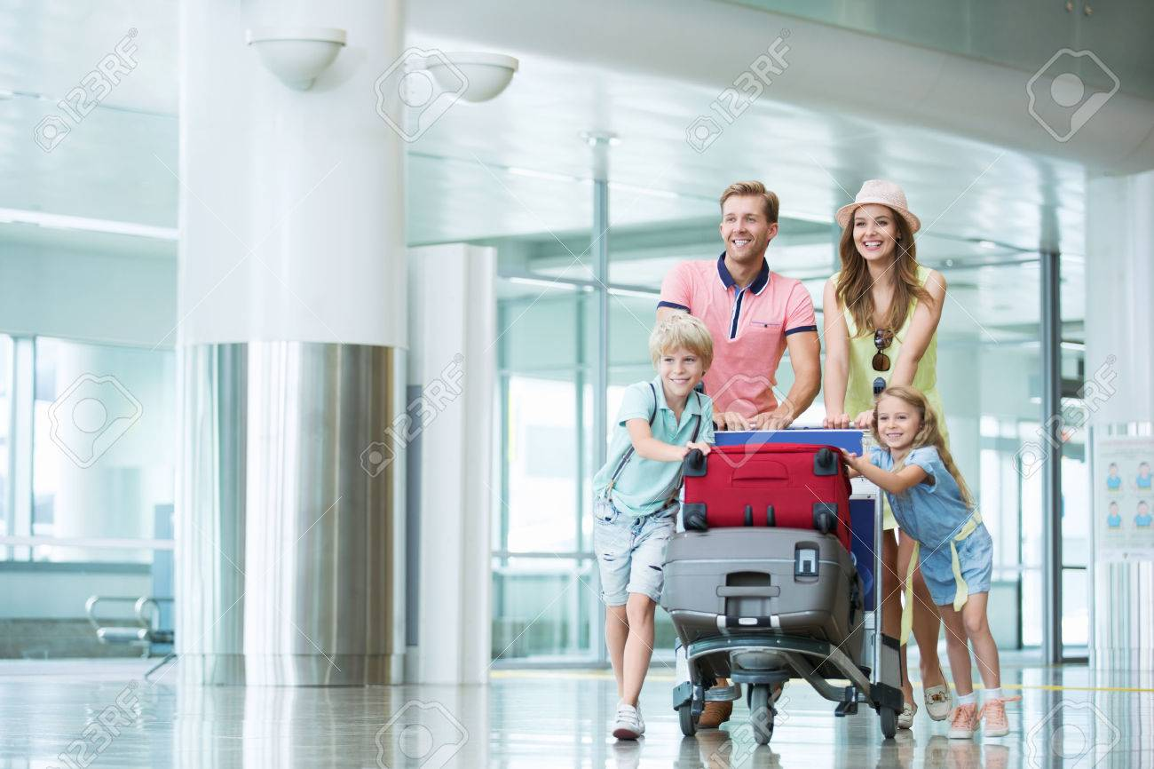 Smiling family with children at the airport Stock Photo - 45036242