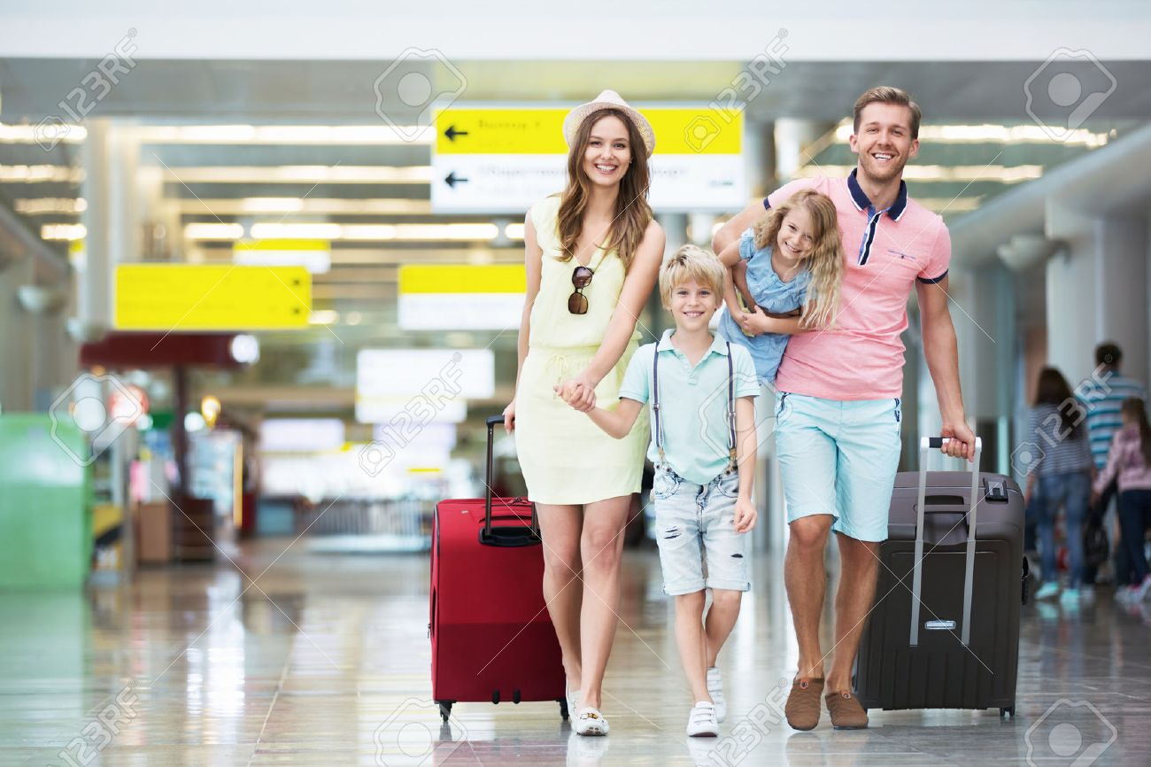 Happy family with suitcases in the airport Stock Photo - 45818113