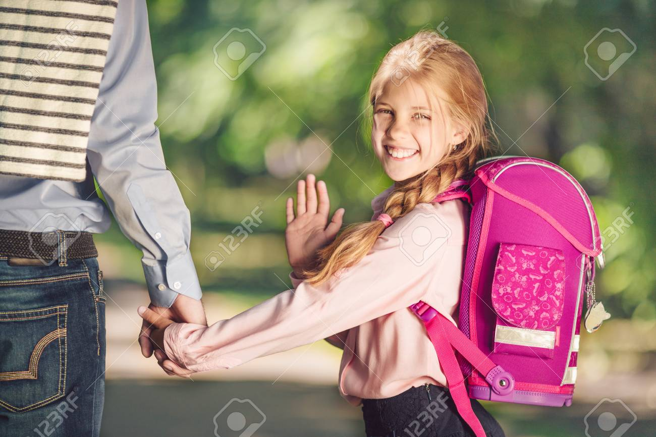 Smiling schoolgirl with a backpack - 110899638