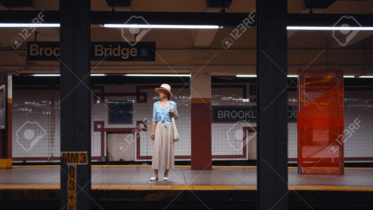 Young tourist waiting for a train at the station in the subway, New York City - 152488014