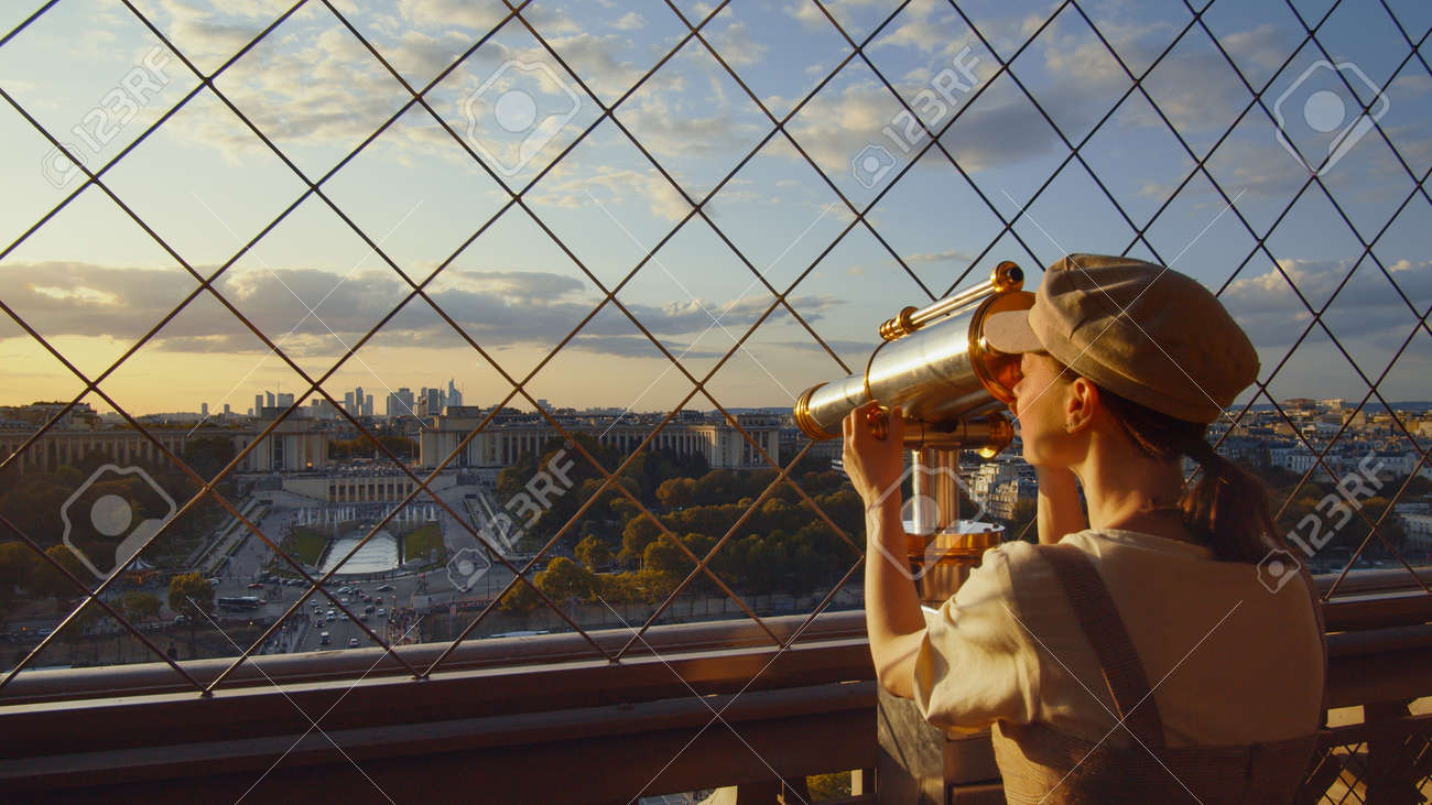 Young tourist looking through binoculars at the view point, Paris - 152488050