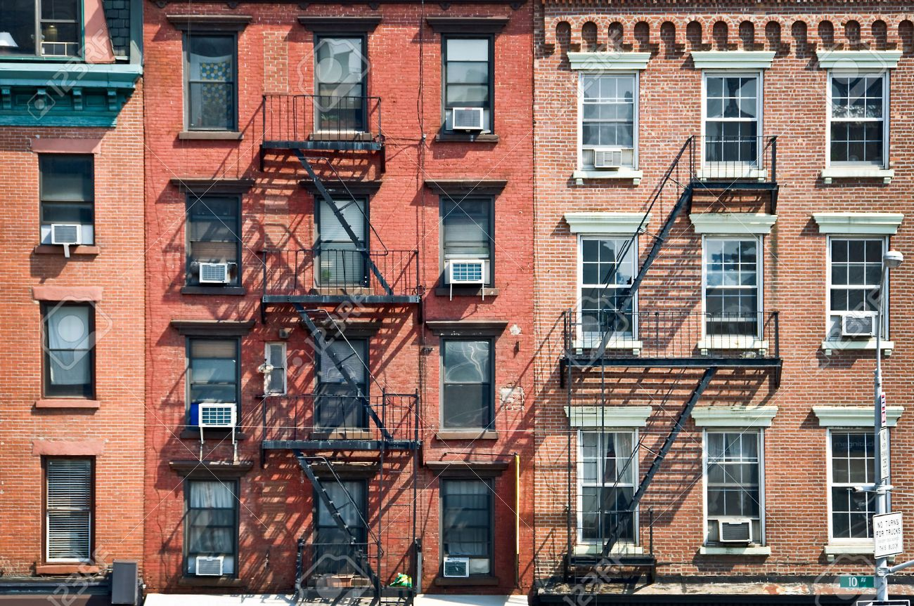New York Brick Buildings With Outside Fire Escape Stairs, USA Stock Photo    33094441