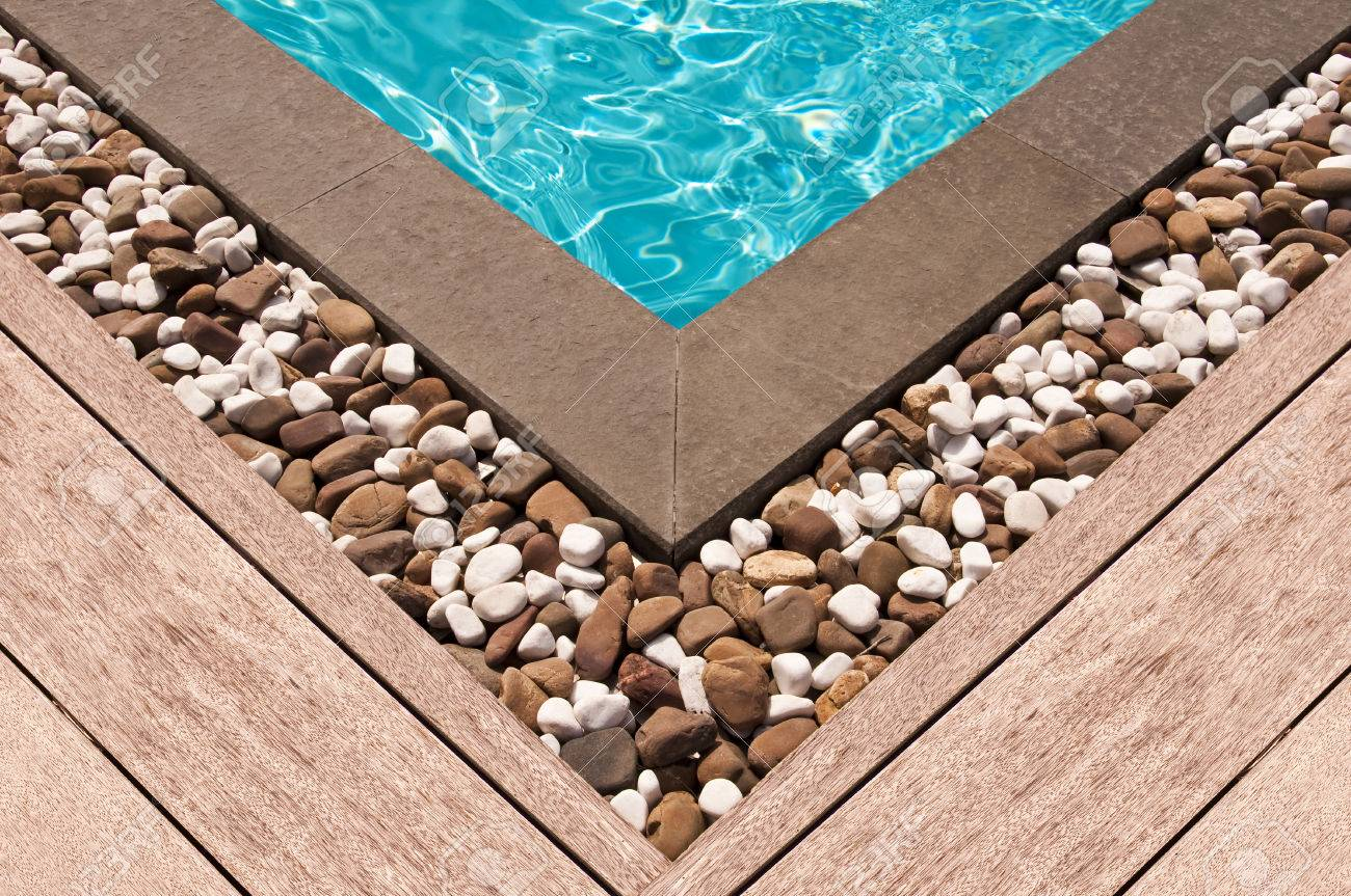 Wooden Deck And Stone At The Corner Of A Swimming Pool Stock Photo Picture And Royalty Free Image Image 38695700