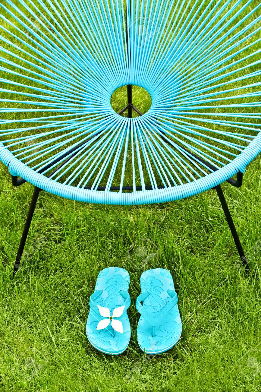 Flip Flop Chair Turquoise Blue Garden Chair And Flip Flops Green Lawn Background