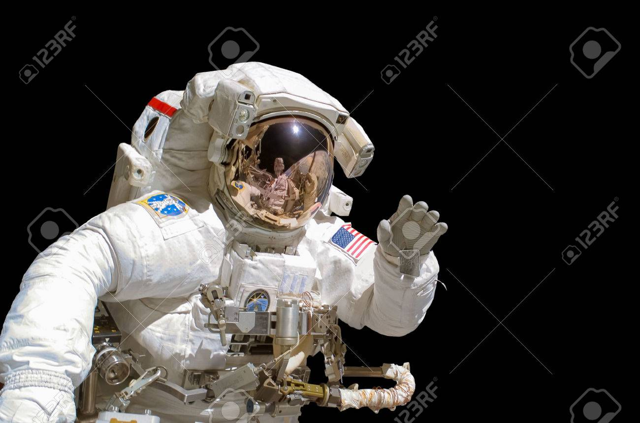 Close up of an astronaut isolated on black background - 52534238