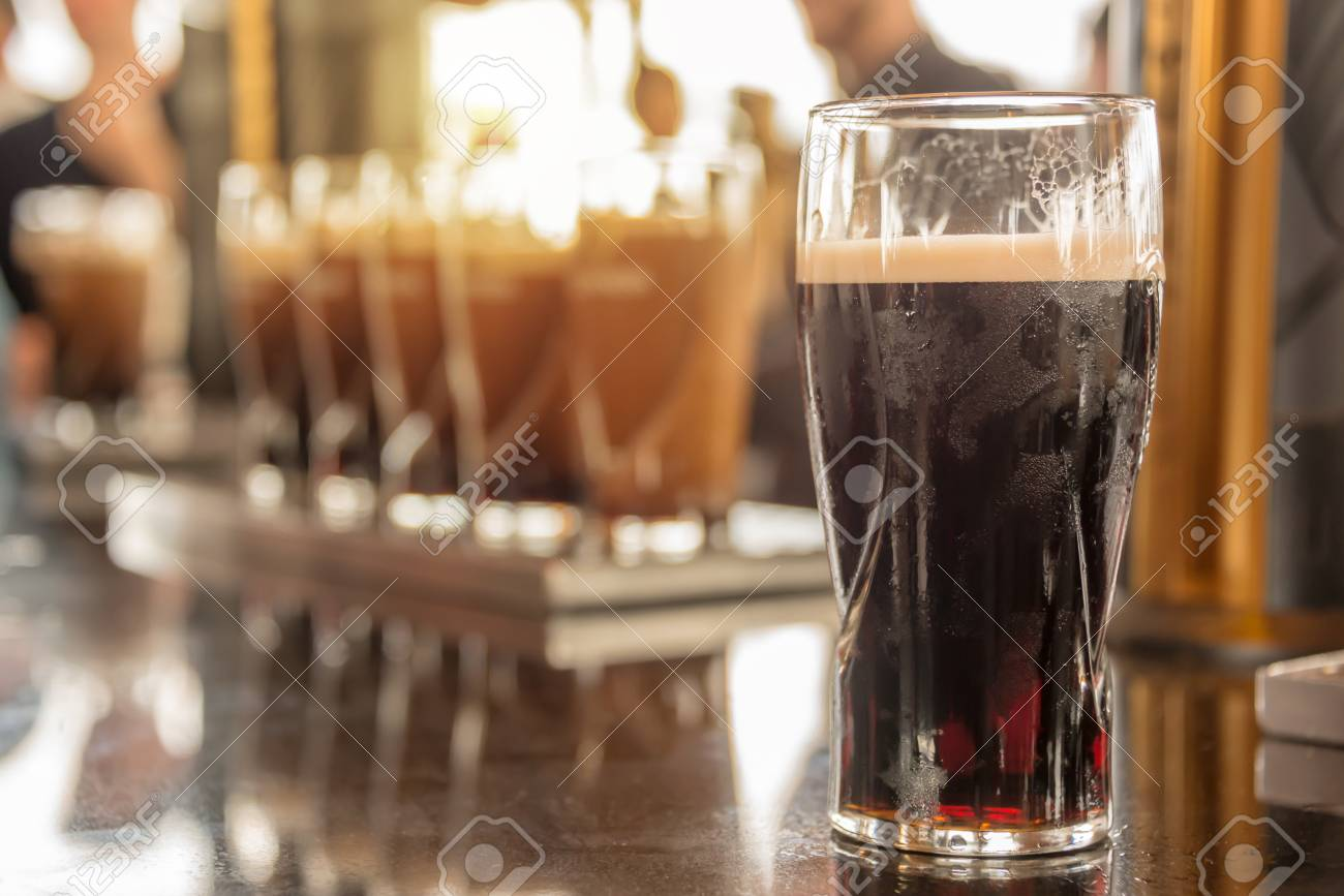 Close up of a glass of stout beer in a bar - 84550671