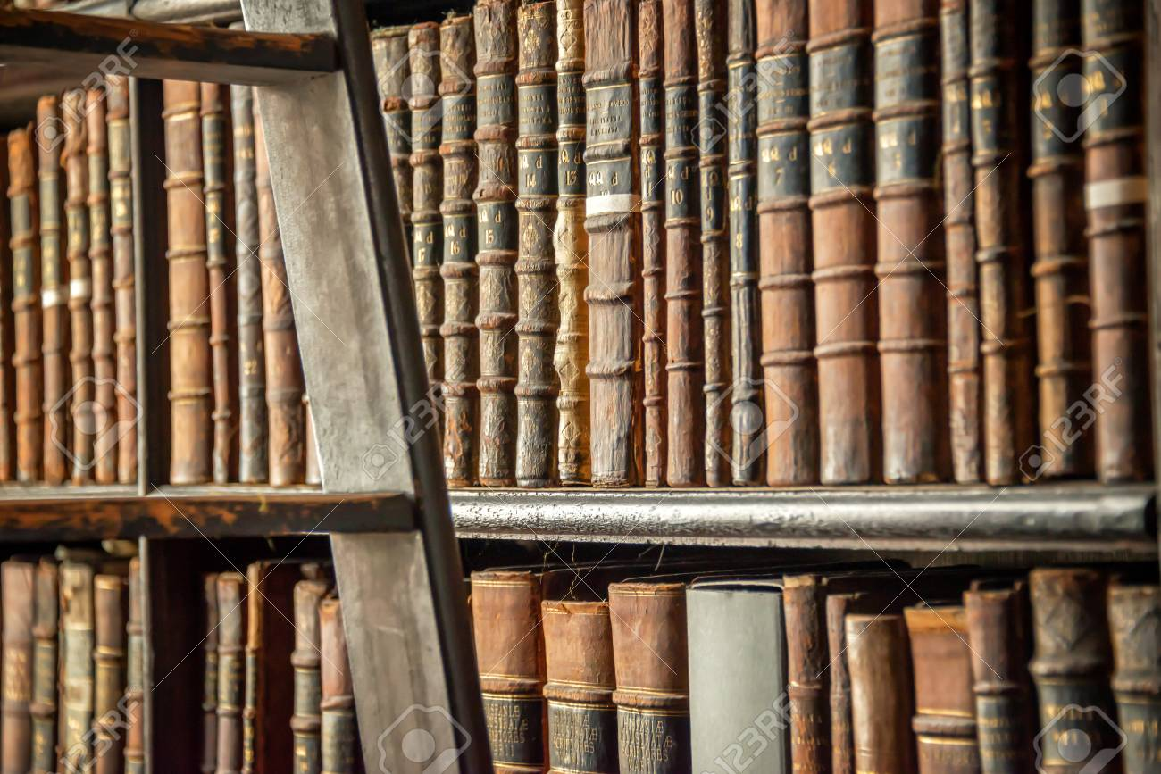 Old Vintage Books On Wooden Bookshelf And Ladder In A Library Stock Photo
