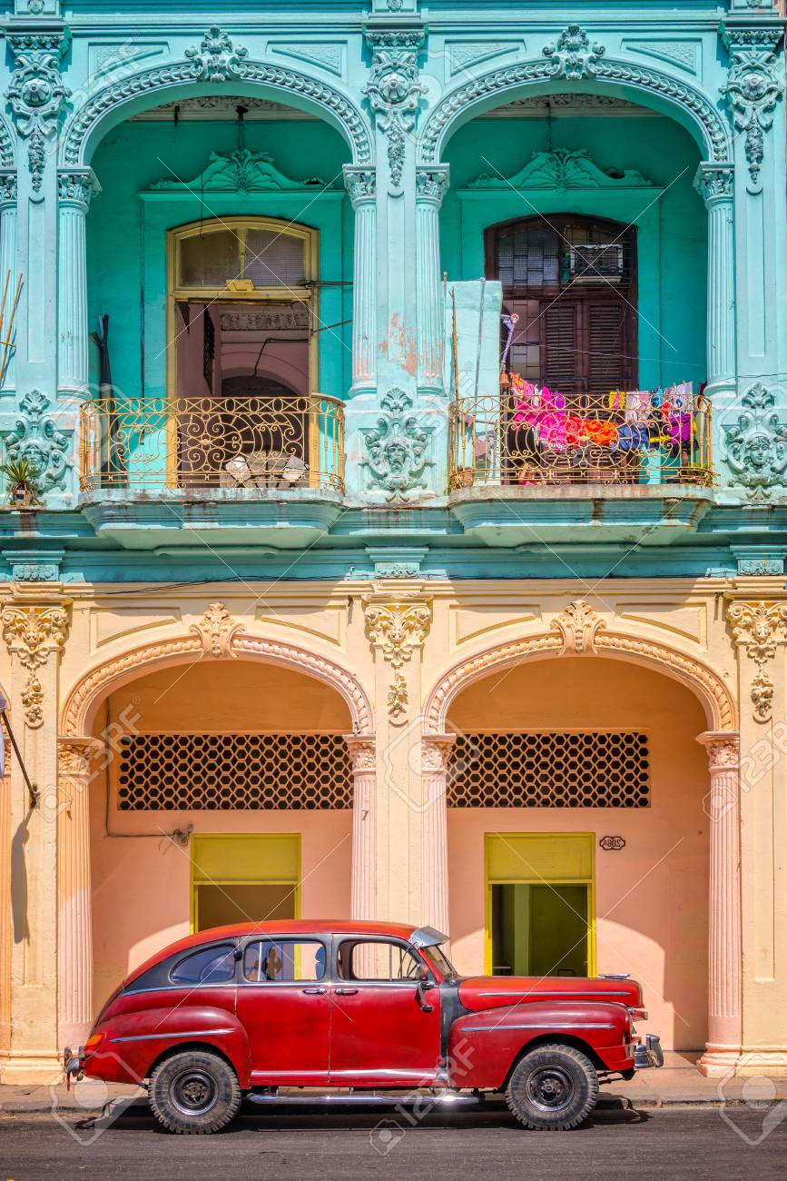 Classic vintage car and colorful colonial buildings in Old Havana, Cuba - 105344568