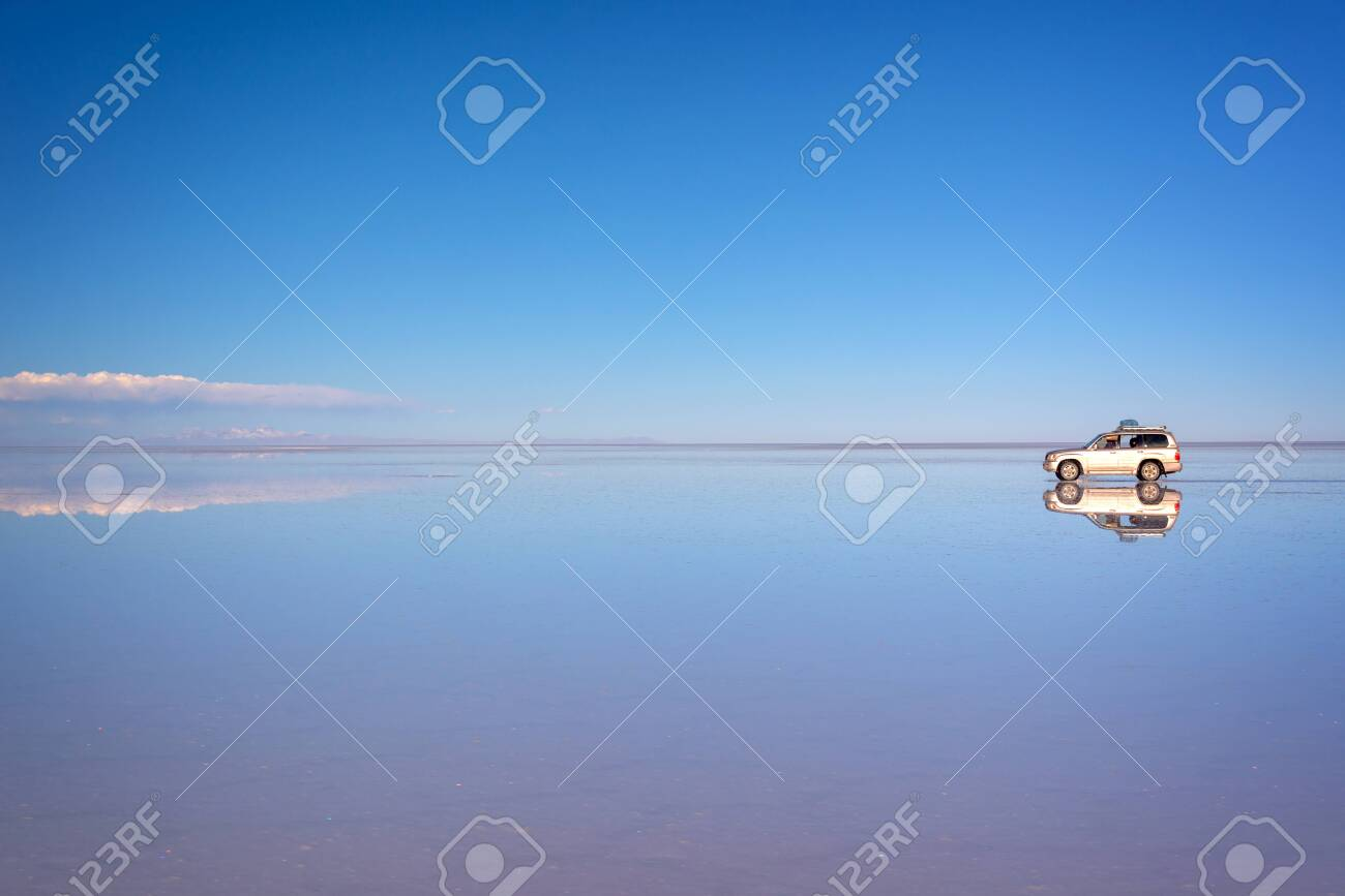 Mirror Effect And Reflections Of A 4x4 Car In Salar De Uyuni