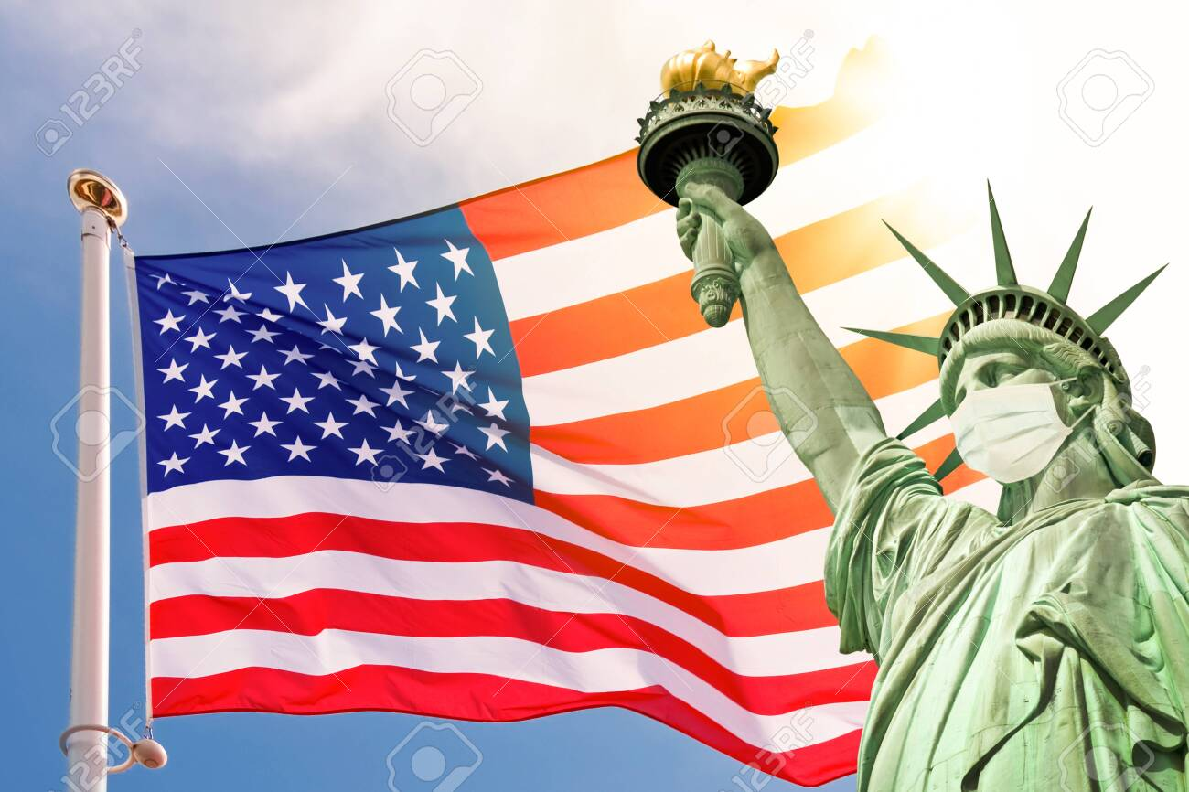 Statue of Liberty wearing a surgical mask, US american flag background. New coronavirus, covid-19 in New York and USA epidemic crisis concept - 143427967