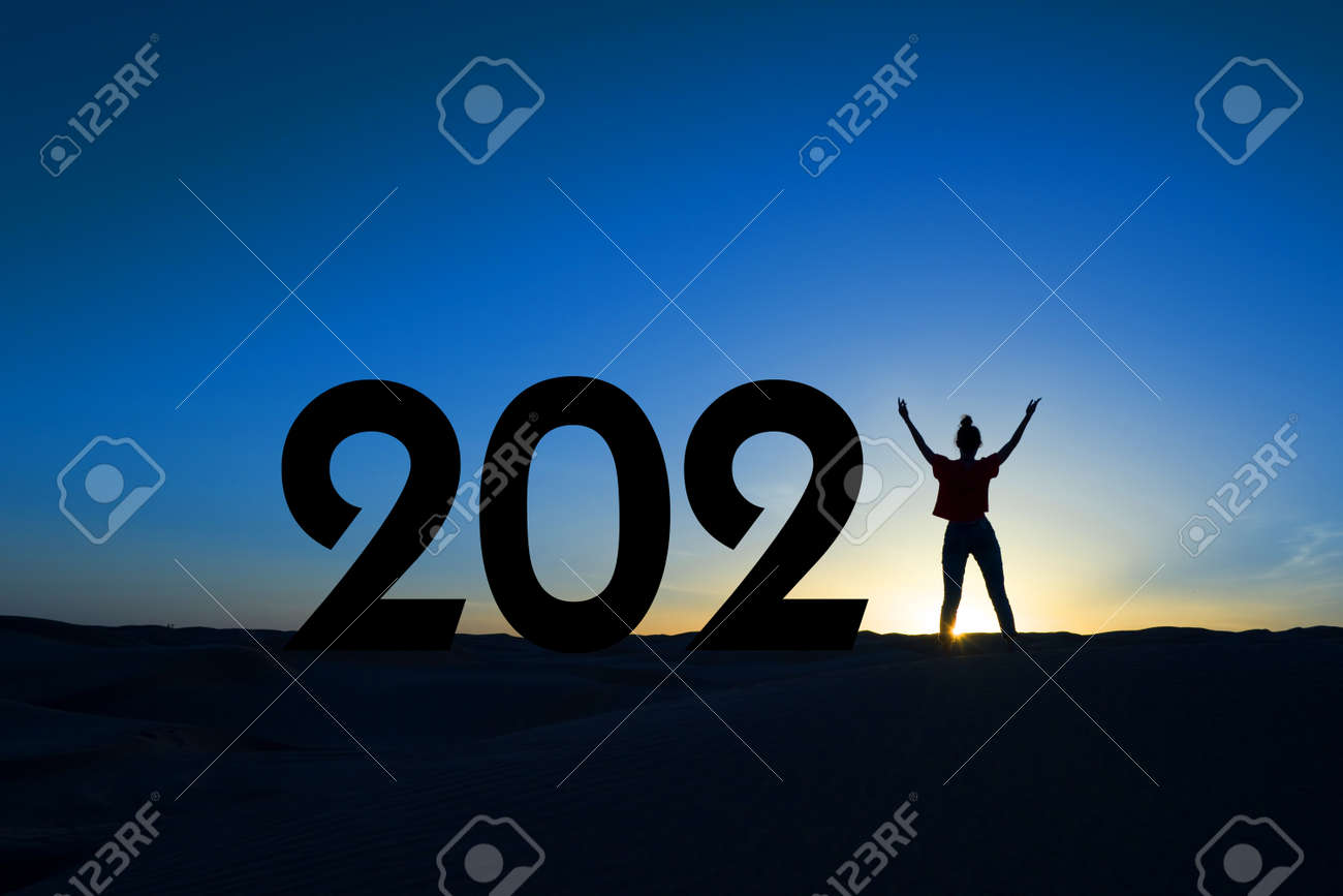 2021, silhouette of a woman standing in the sunrise, women empowerment, feminist new year holiday greeting card - 157592797