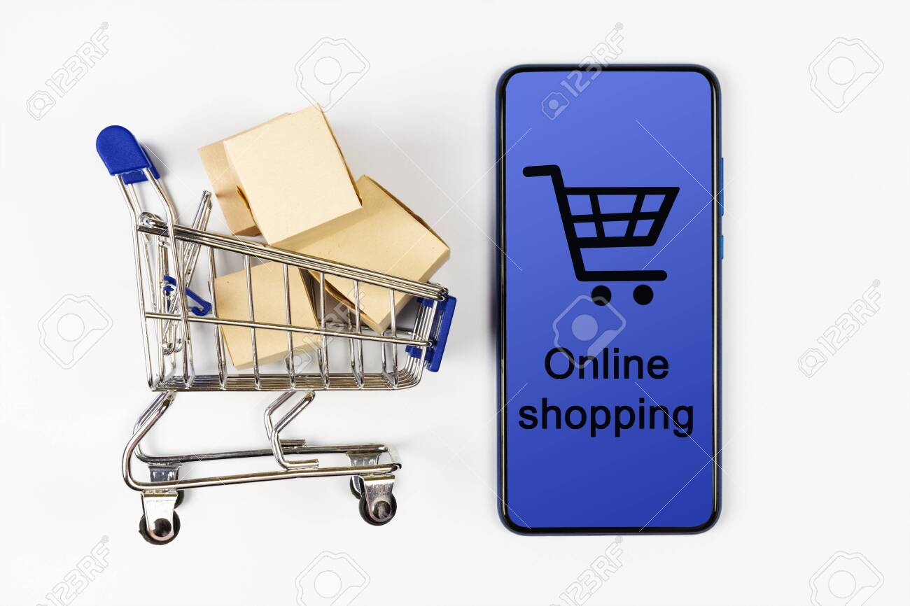 Supermarket cart with boxes and smartphone on white background. Online shopping - 120931623