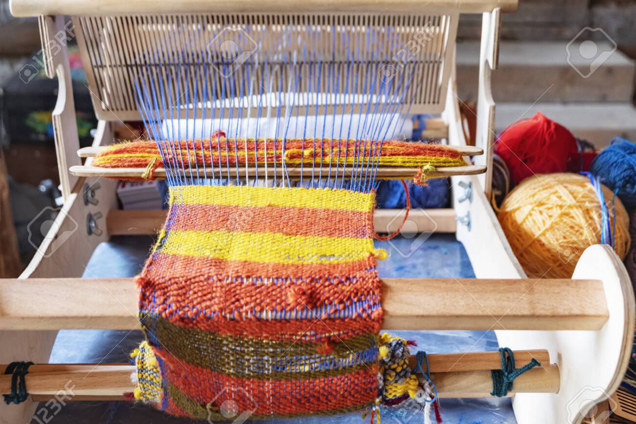 Ancient wooden knitting machine. Reconstruction of an ancient knitting machine - 126844064