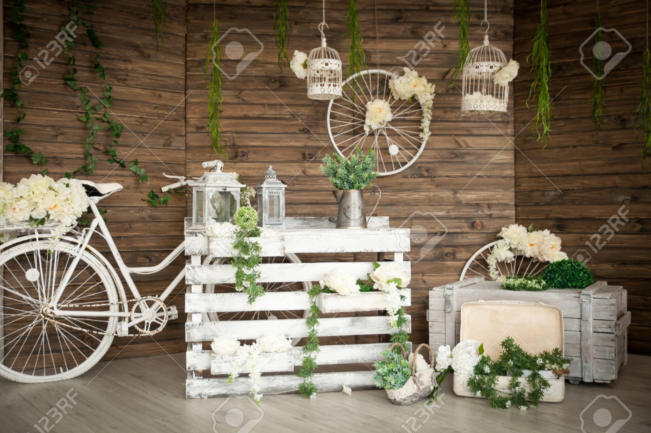 Rustic Decor In A Spring Studio With Wooden Wall And Greenery ...