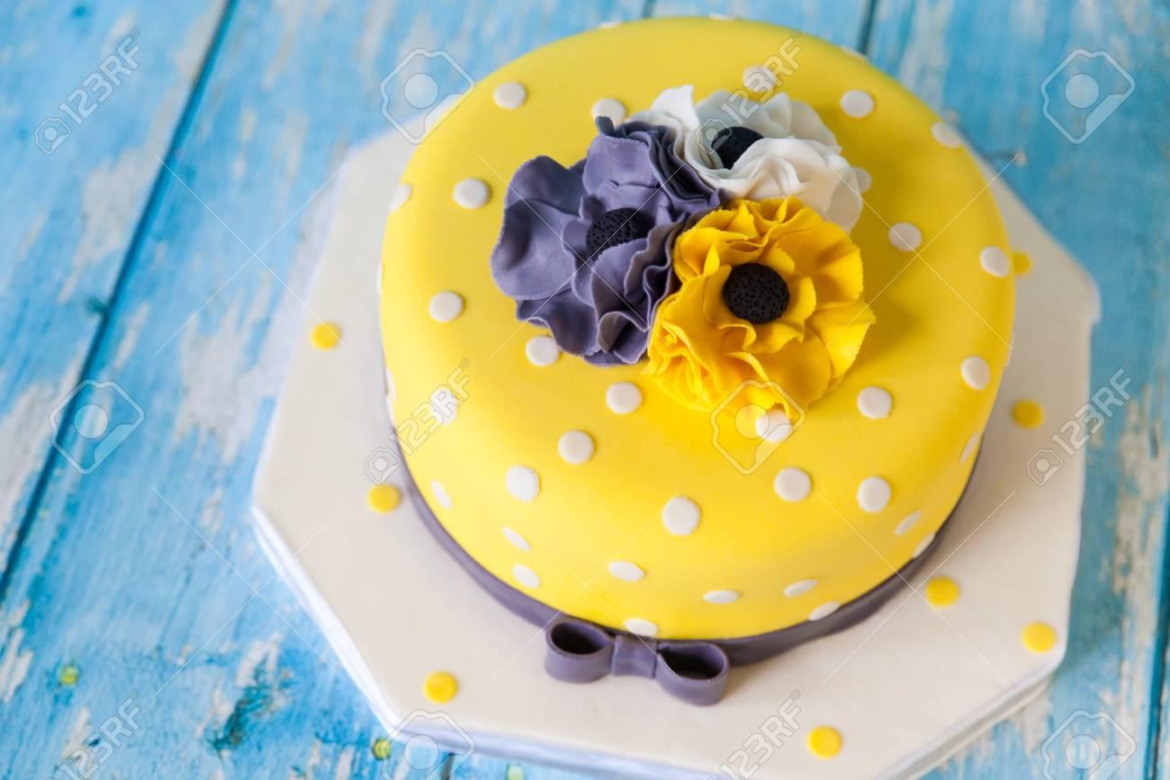 Yellow Birthday Cake With White Grey And Anemones Flowers