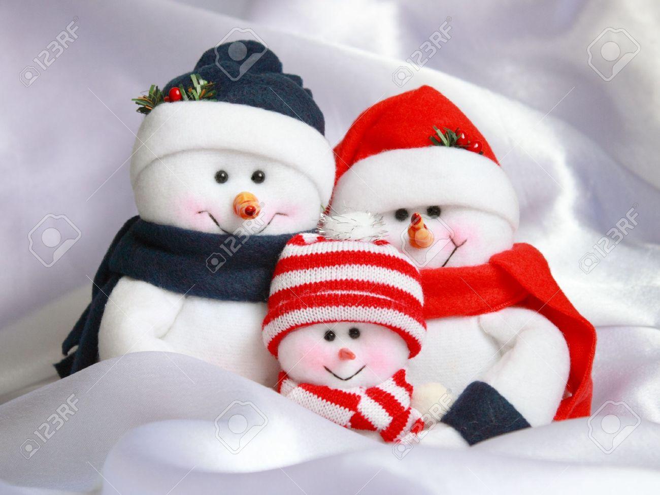 Christmas Snowman Family : Happy Snowmen On White Snow Background ...
