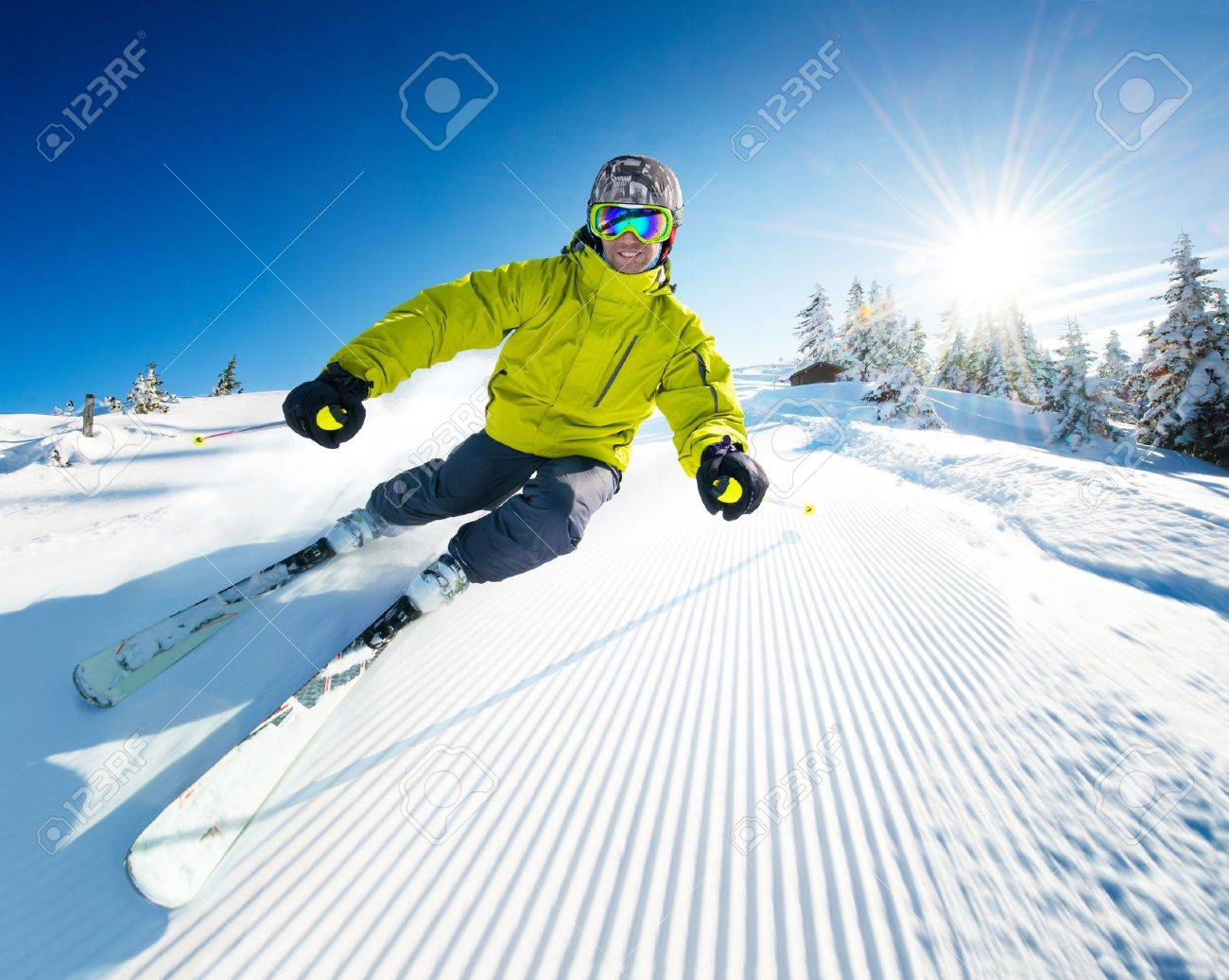 Skier on pise in high mountains - 17753053