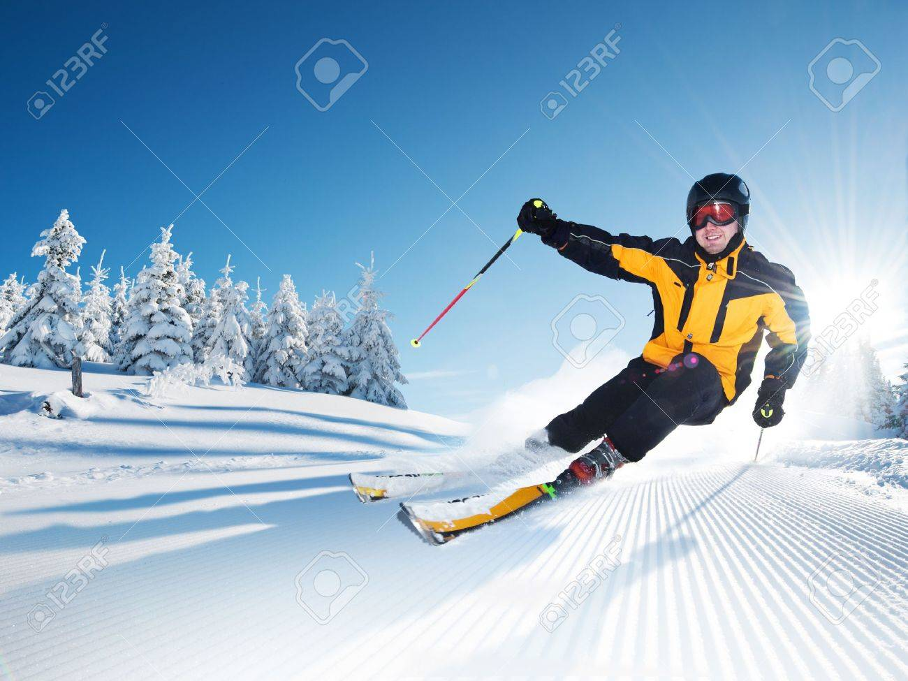 Skier in mountains, prepared piste and sunny day - 17753058