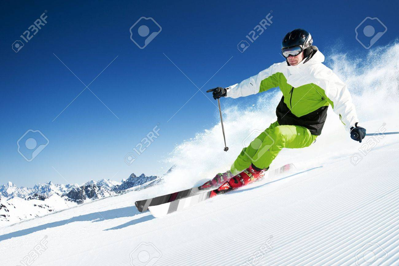 Skier in mountains, prepared piste and sunny day - 17753028