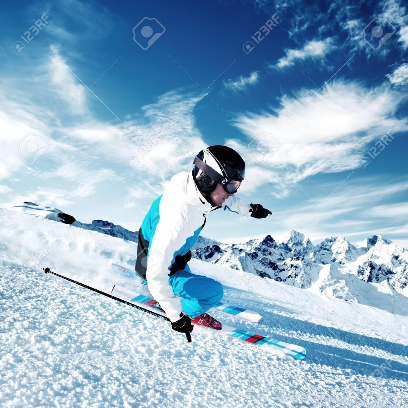 Skier in mountains, prepared piste - 17753054