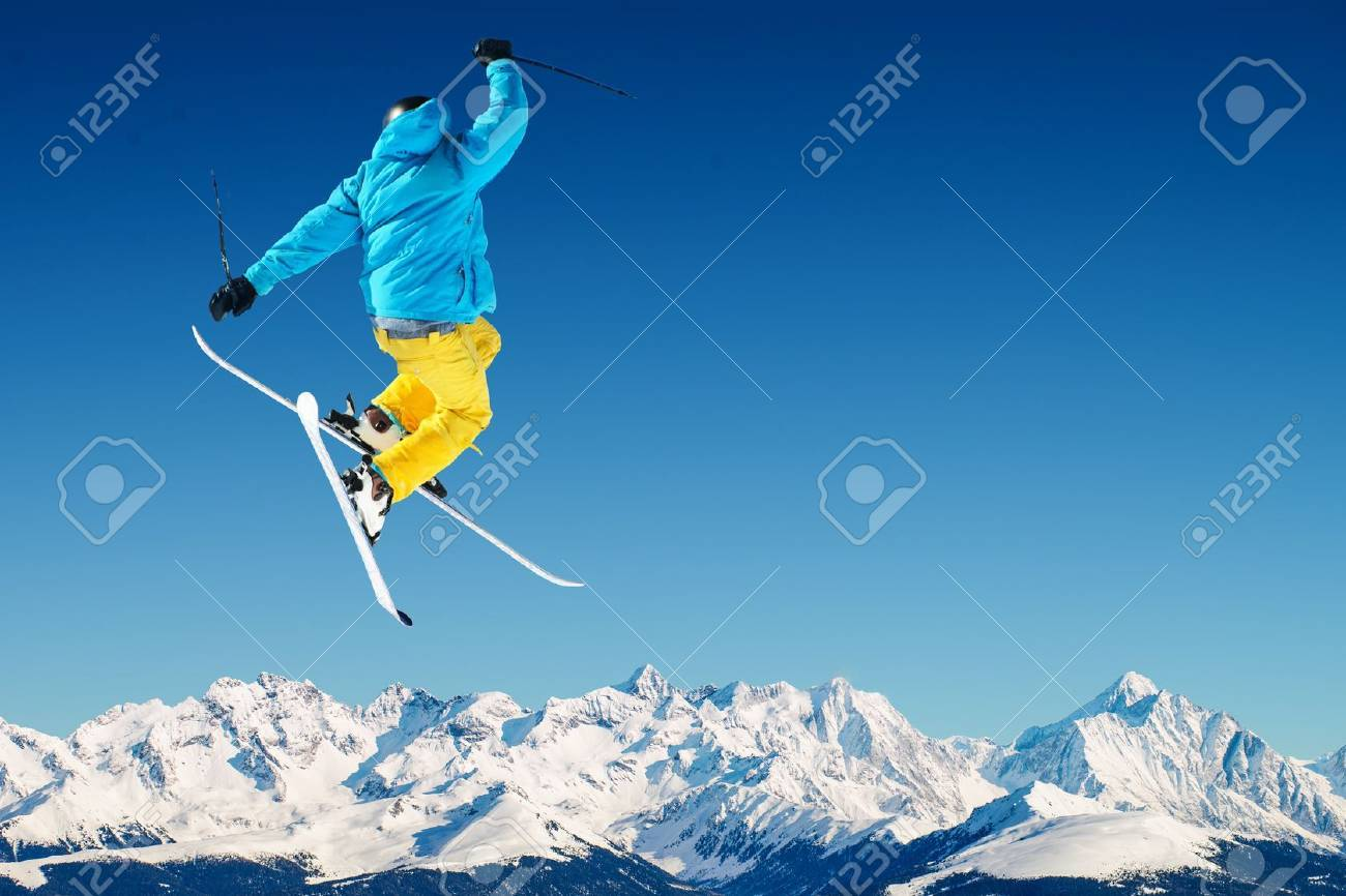 Skier in high mountains - 21686236