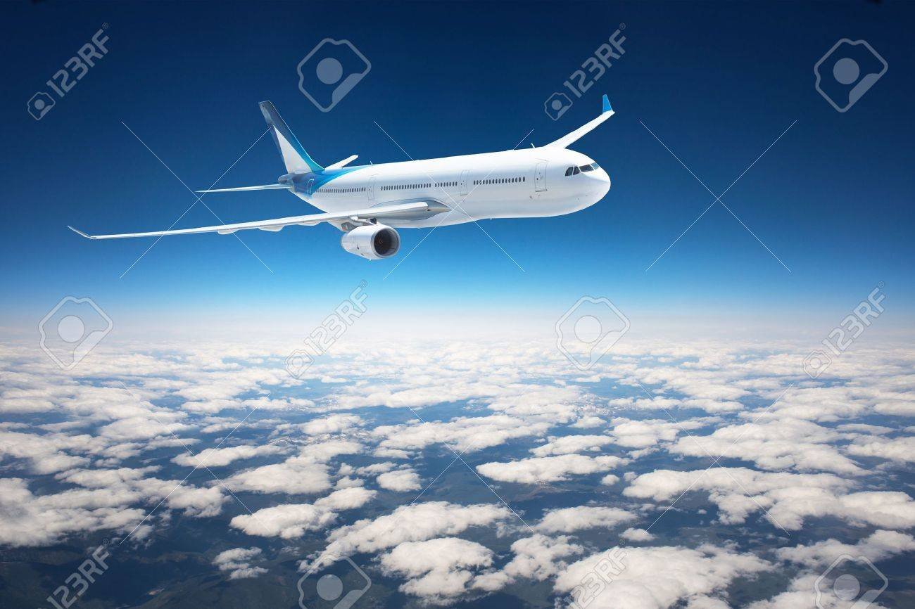 Airplane in the sky - Passenger Airliner aircraft - 21971286