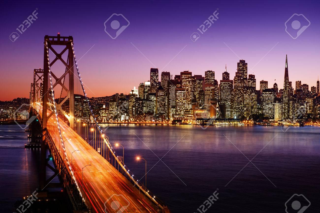 San Francisco skyline and Bay Bridge at sunset, California - 26115786