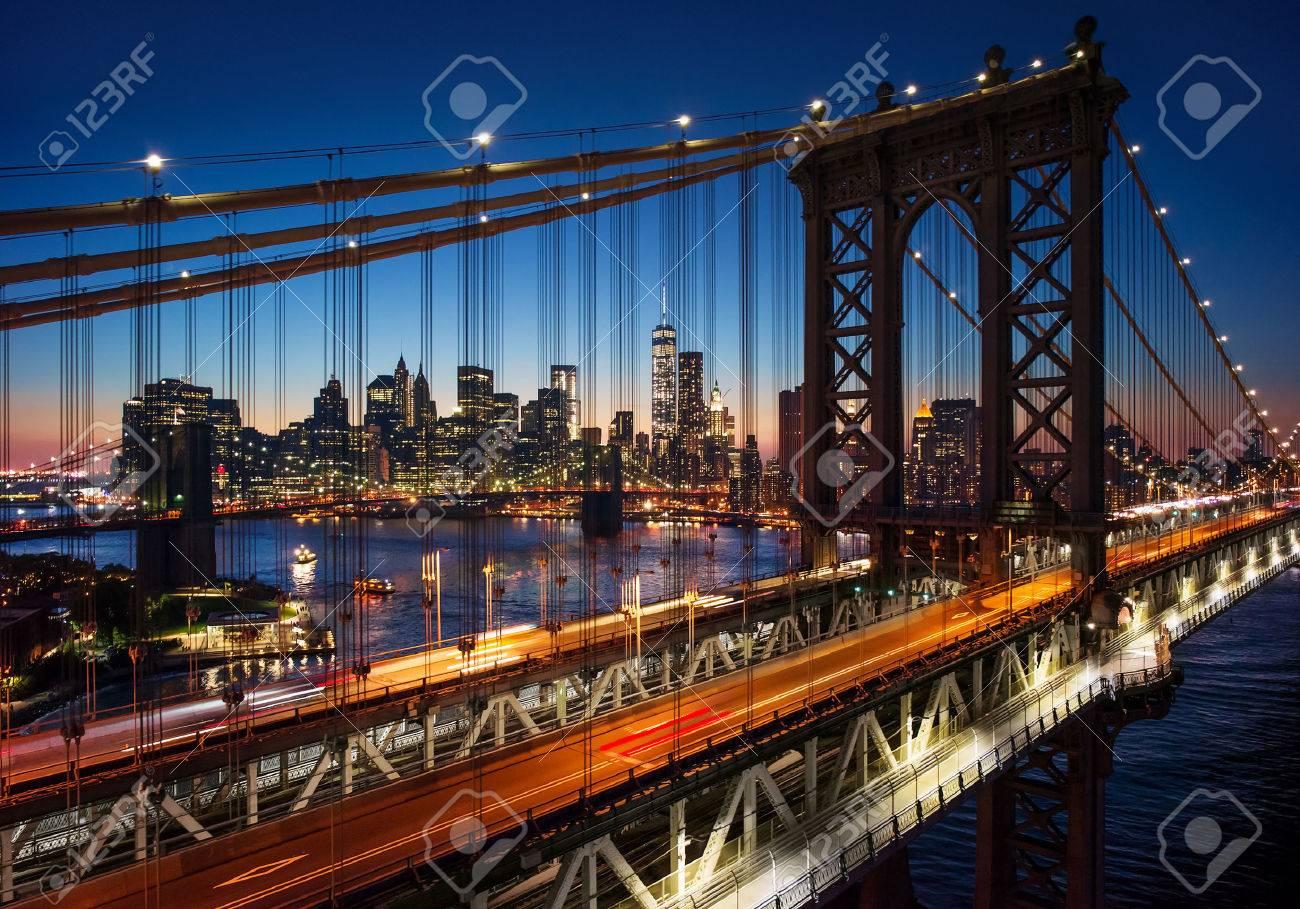 New York City - beautiful sunset over manhattan with manhattan and brooklyn bridge - 32773665