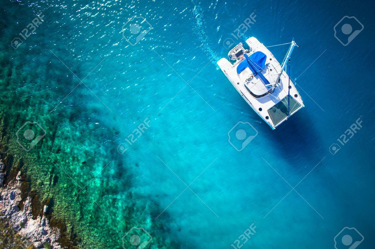 Amazing view to Yacht sailing in open sea at windy day. Drone view - birds eye angle - 32773678