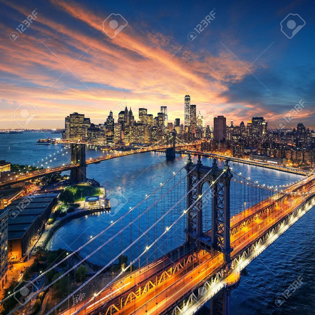 New York City - beautiful sunset over manhattan with manhattan and brooklyn bridge - 32773698