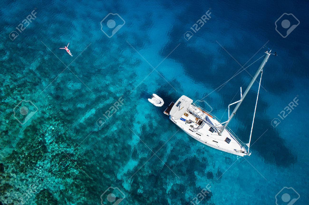 amazing view to yacht, swimming woman and clear water caribbean paradise - 32773875