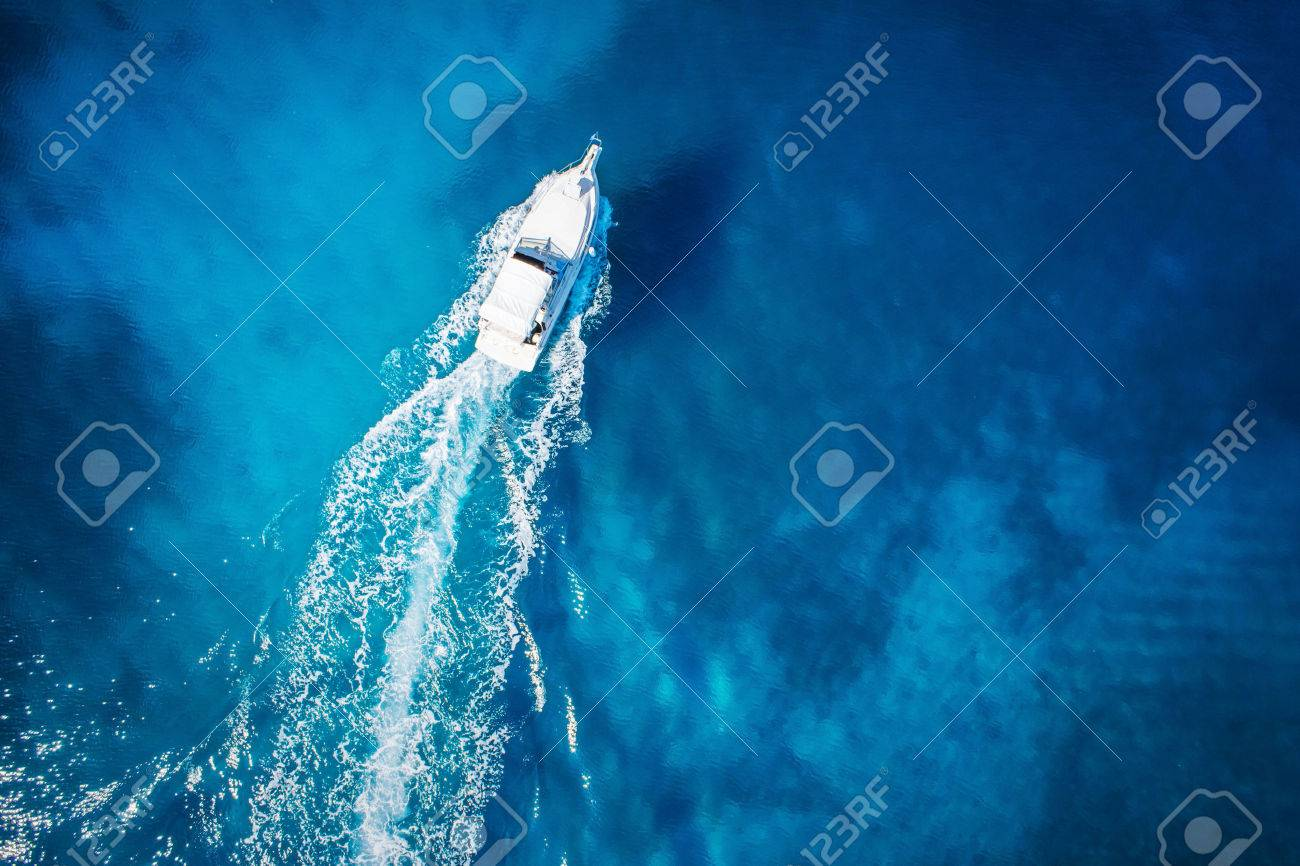 amazing view to yacht, swimming woman and clear water caribbean paradise - 32773879