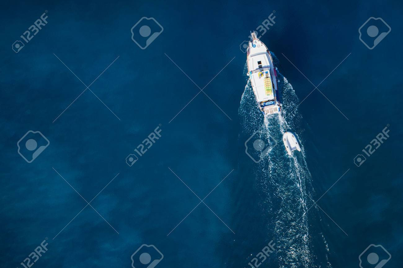 amazing view to yacht, swimming woman and clear water caribbean paradise - 32773880