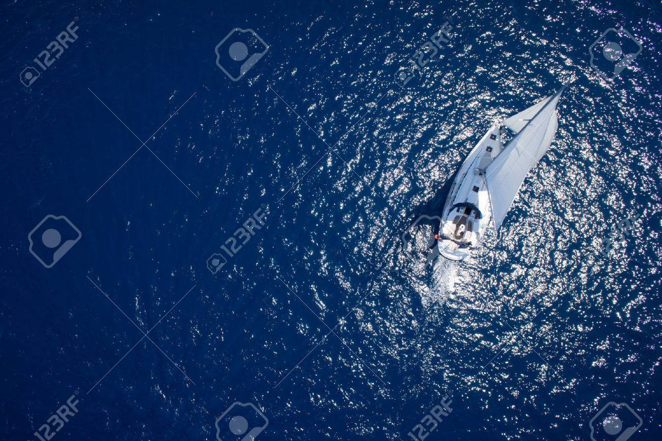 Amazing view to Yacht sailing in open sea at windy day. Drone view - birds eye angle - 32773881