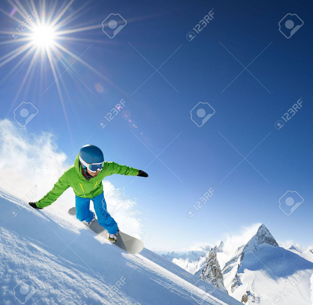 Snowboarder skiing in high mountains. - 43953029