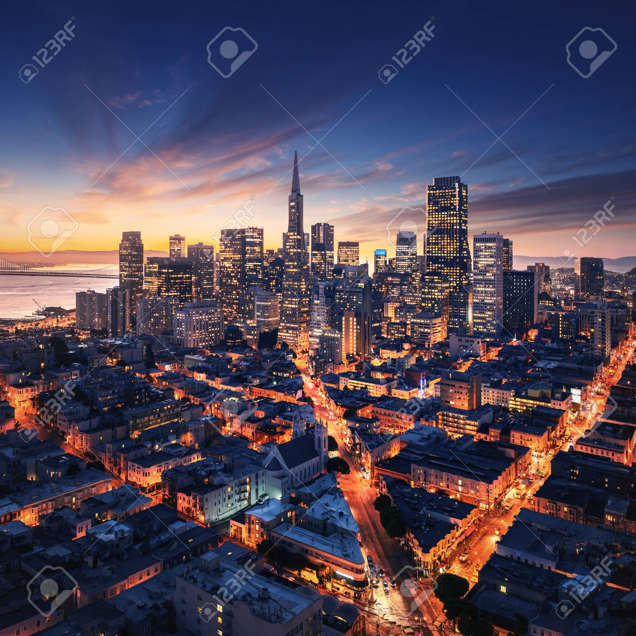 San Francisco aerial view from sea side. Port of San Francisco in the front. City downtown and skyscrapers at sunrise. - 100284985