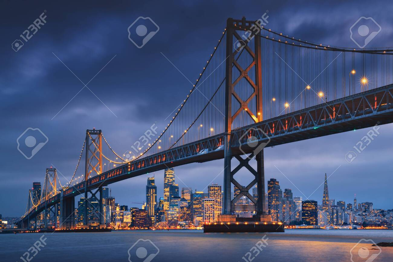 San Francisco downtown with Oakland Bridge in foreground. California famous city SF. Travel destination USA - 141644260