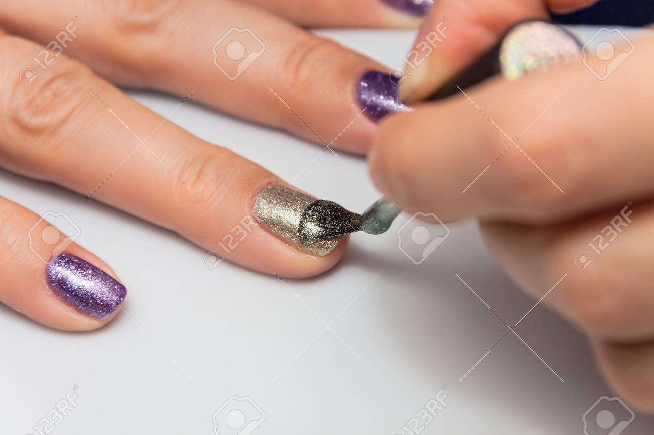 Manicure, Applying Gel Nail Polish On The Nails Of The Fingers Stock ...