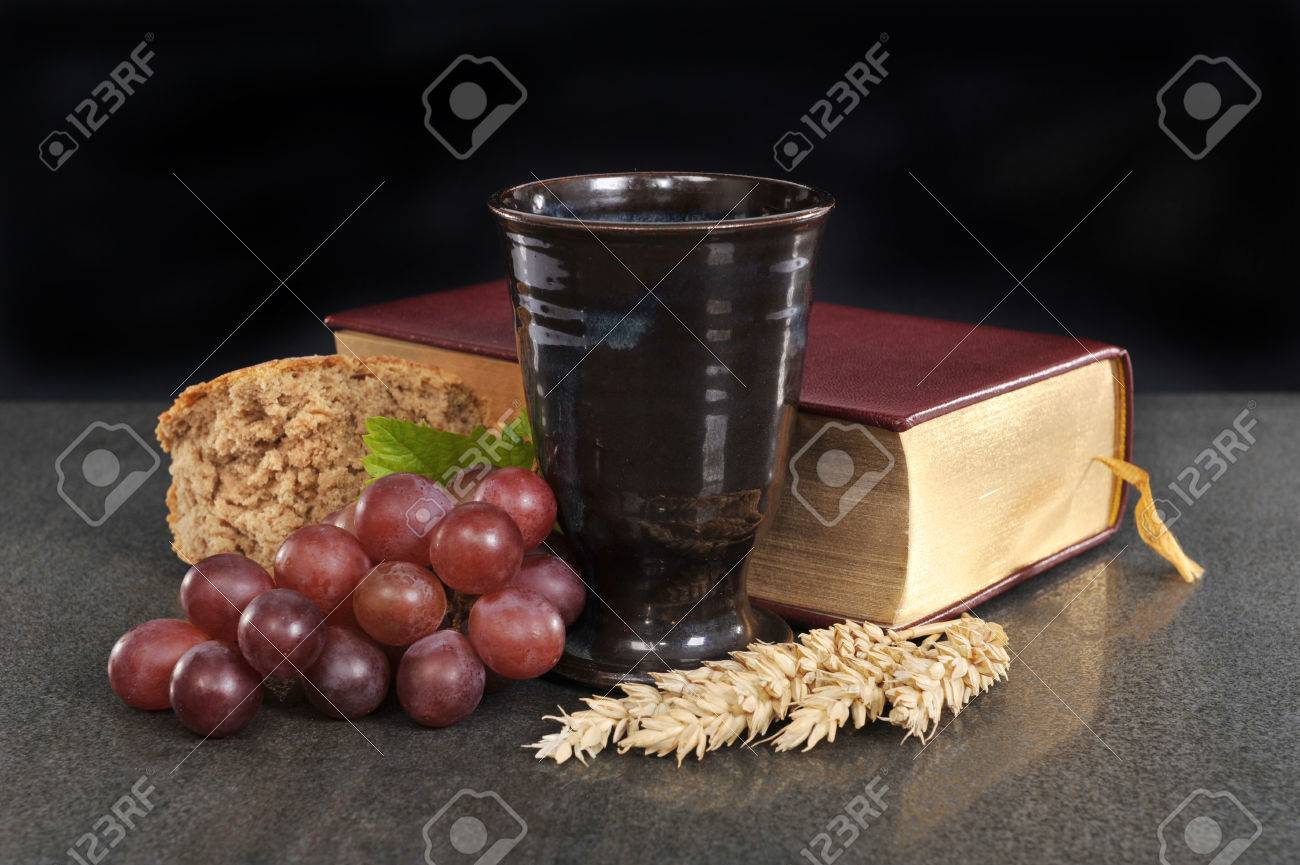 bread wine and bible for sacrament or communion stock photo