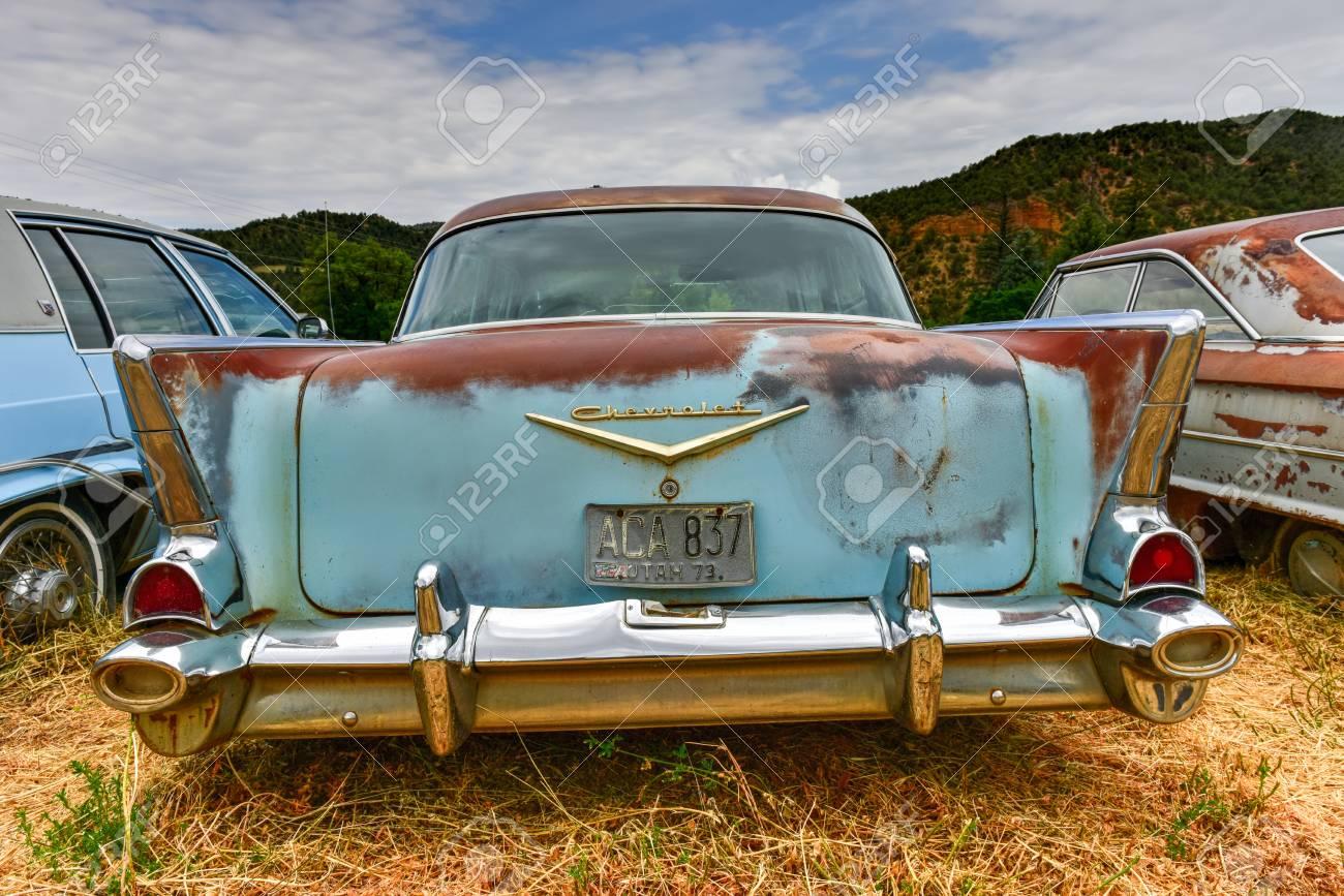 Rusting old car in a desert junk yard