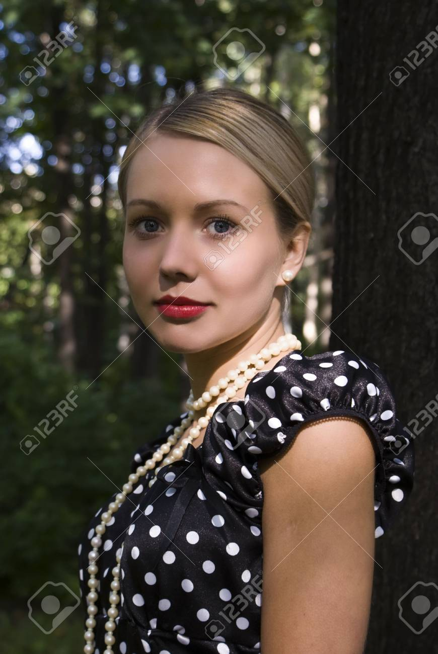 Beautiful girl in park on a foliage background Stock Photo - 5459556