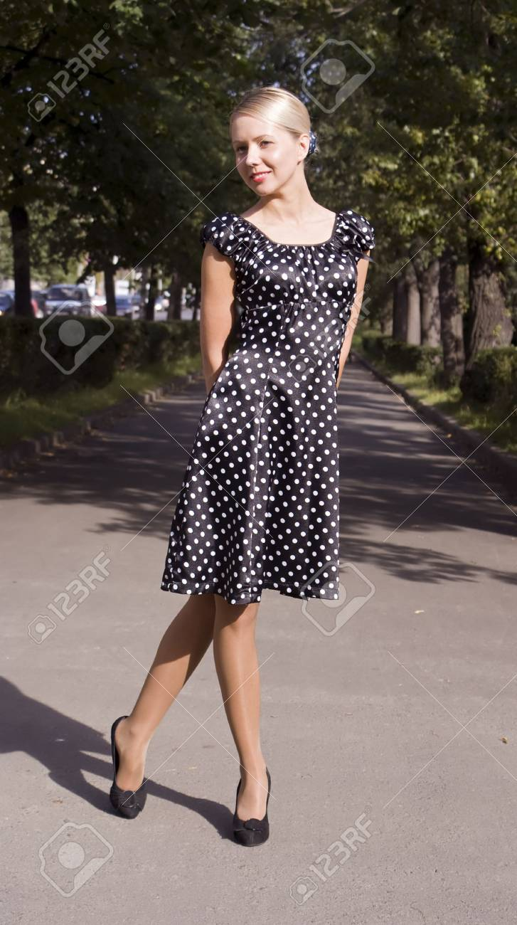 Beautiful girl in a retro style on city streets Stock Photo - 5459566