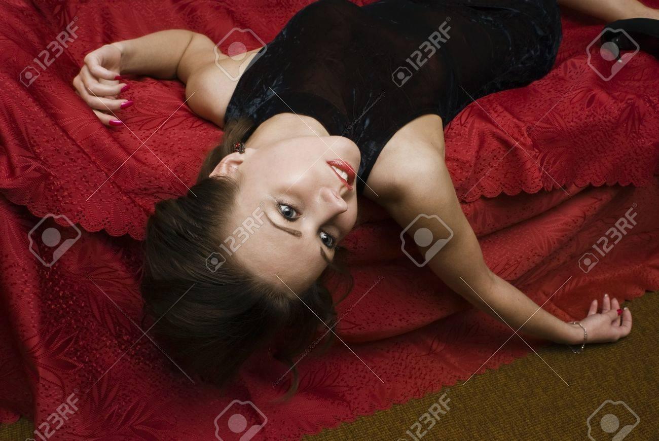 Dead woman lying on the sofa. Studio shot. Stock Photo - 6262423