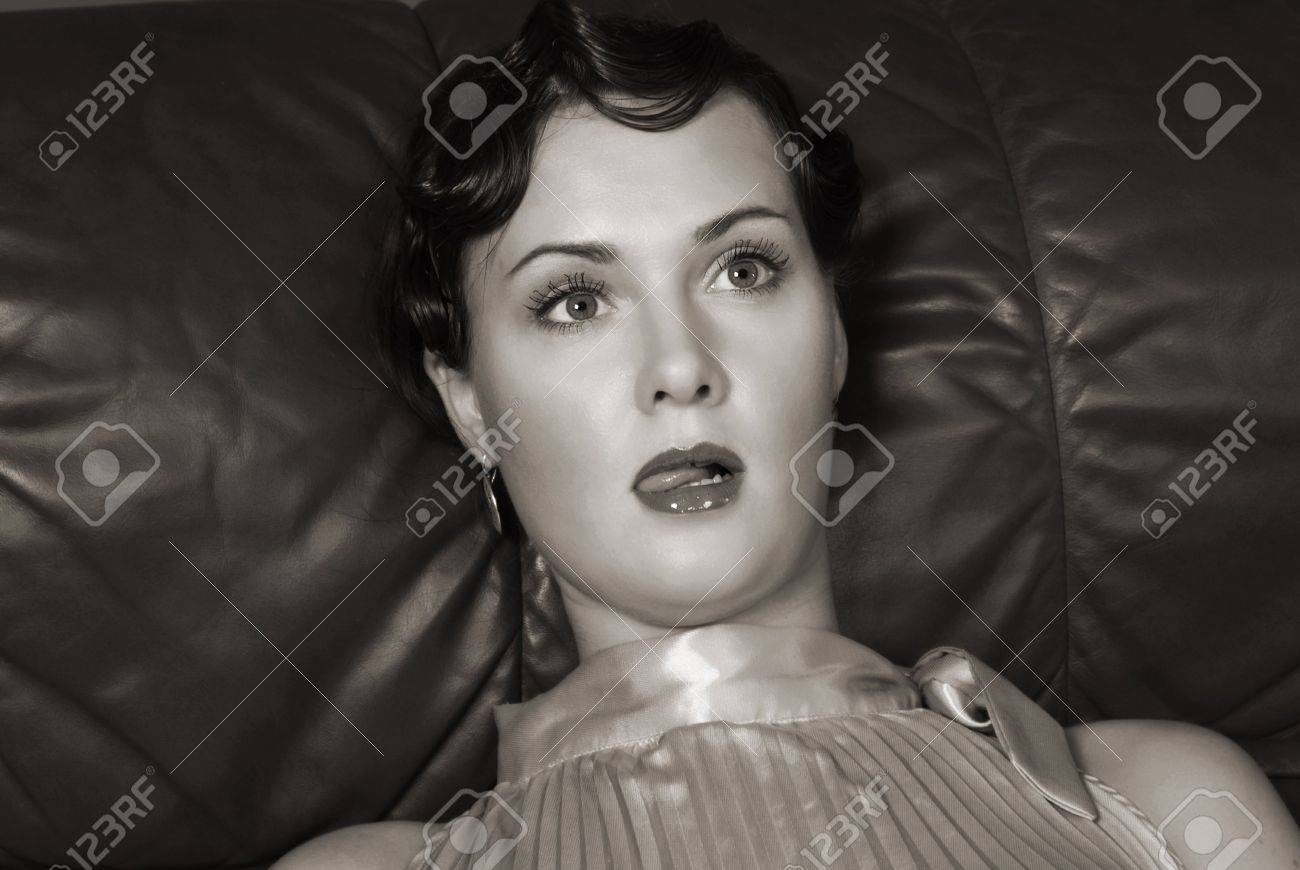 Strangled beautiful young woman. Studio shot in a retro style Stock Photo - 6262311